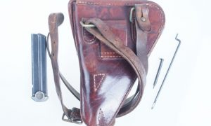 Japanese T14 Holster Rig including Shoulder Strap, Cleaning Rod, Spare Firing Pin (#409) and Late Magazine (#540).